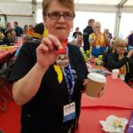 Susan from Lanark shows off her medal at the finish line!